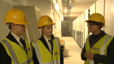 Students Emma and Oscar with Project Manager Henrietta pictured inside the new archive facility alongside the brand new roller racking